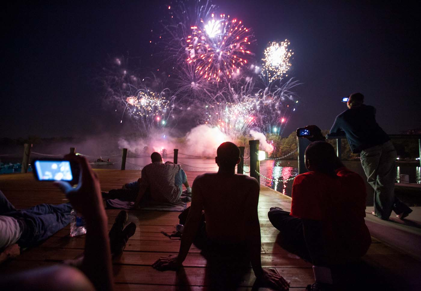 COLUMBIA, MD - JULY 04: People watch a fireworks display at the Lakefront. (Nate Pesce for Patuxent Homestead)