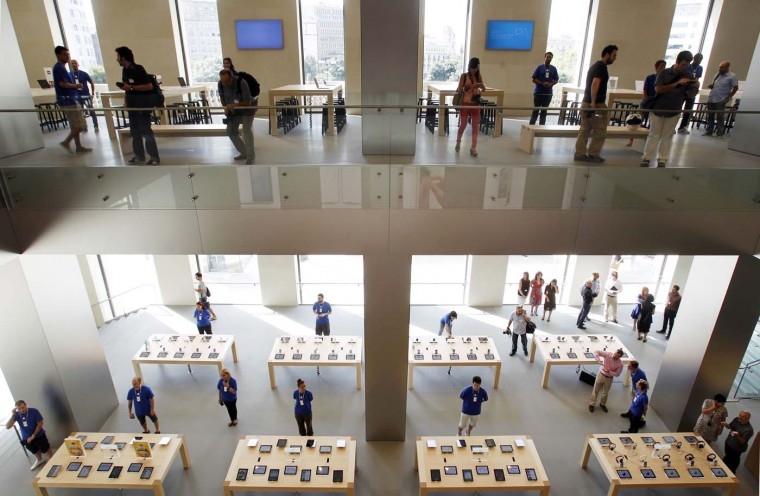 Employees and members of the media are pictured in the Passeig de Gracia Apple store in Barcelona July 26, 2012. The store will become Apple's largest store in southern Europe when it opens officially on July 28. (Albert Gea/Reuters)