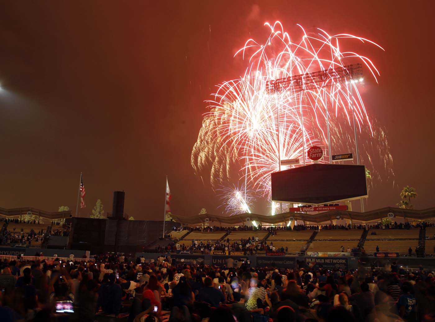 LOS ANGELES, CA - JULY 04: The Fourth of July Fireworks show behind the scoreboard at Dodger Stadium. (Alex Gallardo/Reuters)