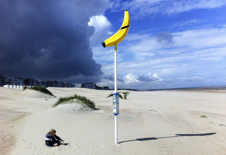 Three year-old boy Alessandro plays near a banana-shaped meeting point for lost children on the beach of Oostduinkerke, Belgium. (Yves Herman/Reuters)