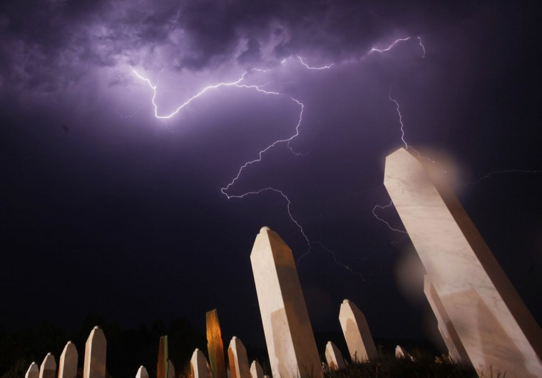 Lightning is seen during a storm under the Memorial Center in Potocari the night before a mass burial, near Srebrenica. The bodies of 520 recently identified victims of the Srebrenica massacre will be buried on July 11, the anniversary of the massacre when Bosnian Serb forces commanded by Ratko Mladic slaughtered 8,000 Muslim men and boys and buried them in mass graves, in Europe's worst massacre since World War Two. (Dado Ruvic/Reuters)