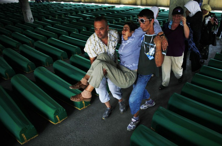 Bosnian Muslims carry an unconscious woman past coffins of her relatives, prepared for a mass burial at the Memorial Center in Potocari, near Srebrenica. The bodies of 520 recently identified victims of the Srebrenica massacre will be buried on July 11, the anniversary of the massacre when Bosnian Serb forces commanded by Ratko Mladic slaughtered 8,000 Muslim men and boys and buried them in mass graves, in Europe's worst massacre since World War Two. (Dado Ruvic/Reuters)