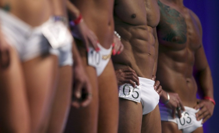 Contestants take part in the Boy and Girl Fitness Sao Paulo 2012 contest in Sao Paulo July 14, 2012. The annual contest received more than 2 million entries, according to the organizers. (Paulo Whitaker/Reuters)