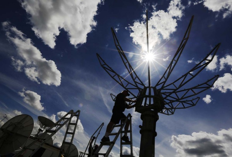 Workers construct satellite dishes for the world's media ahead of the Olympic Games in the London 2012 Olympic Park at Stratford in London. Preparations for the London Olympics have put Britain's intelligence agencies under significant pressure, as the country stages its largest ever peacetime security operation. (Luke MacGregor/Reuters photo)