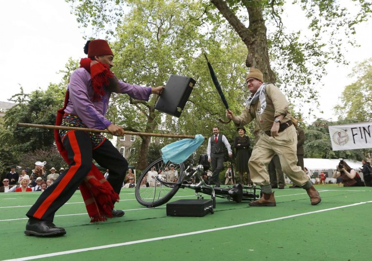 Competitors take part in bicycle jousting at the Chaps Olympiad at Bedford Square in central London, July 8, 2012. (Olivia Harris/Reuters)