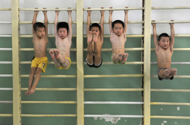 Gymnasts from the Nanjing children's gymnastic team stretch during a training session at a sports centre in Nanjing, Jiangsu province. The team with about thirty young gymnasts, between the ages of four to eight, is the representative of Nanjing city for the provincial gymnastic games. (Sean Yong/Reuters)