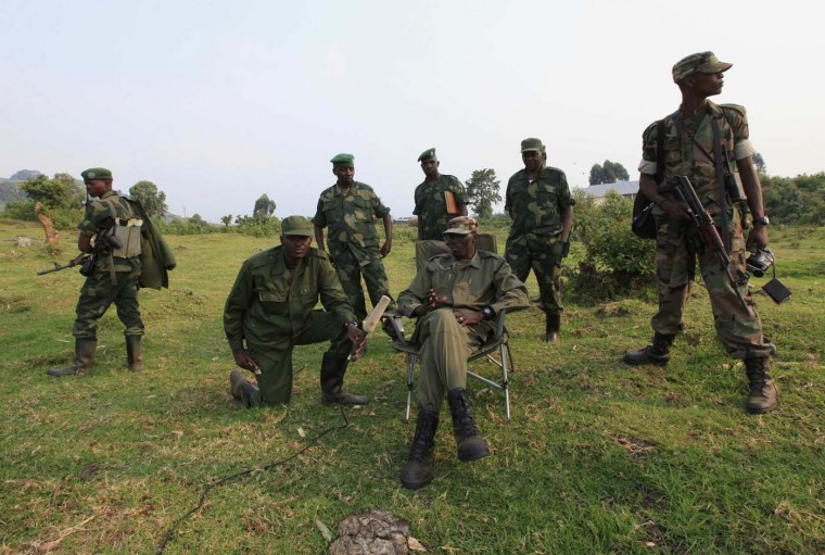 Colonel Sultani Makenga (seated), leader of M23 rebel group, speaks during an interview with Reuters in the eastern DRC town of Bunagana, near the Uganda border, July 8, 2012. Rebels in eastern Democratic Republic of Congo said on Sunday they seized the town of Rutshuru in North Kivu province after government forces abandoned it. (James Akena/Reuters)