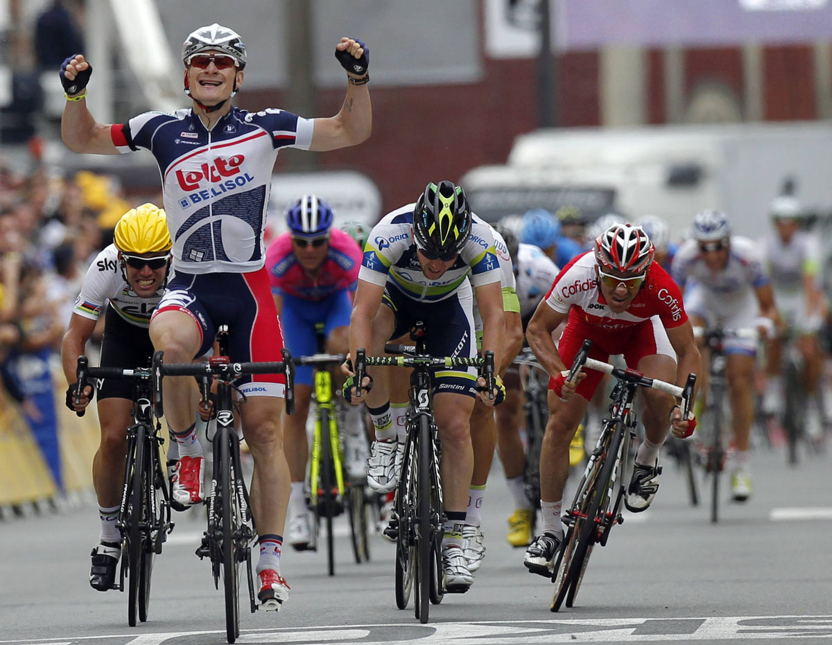 Lotto-Belisol Team rider Andre Greipel of Germany holds up his arms as he wins the fifth stage of the 99th Tour de France cycling race between Rouen and Saint-Quentin. (Stephane Mahe/Reuters)