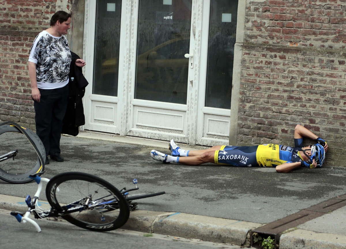 Team Saxo Bank rider Jonathan Cantwell of Australia lies on the ground after a fall during the fifth stage of the 99th Tour de France cycling race between Rouen and Saint-Quentin. (Joel Saget/Reuters)