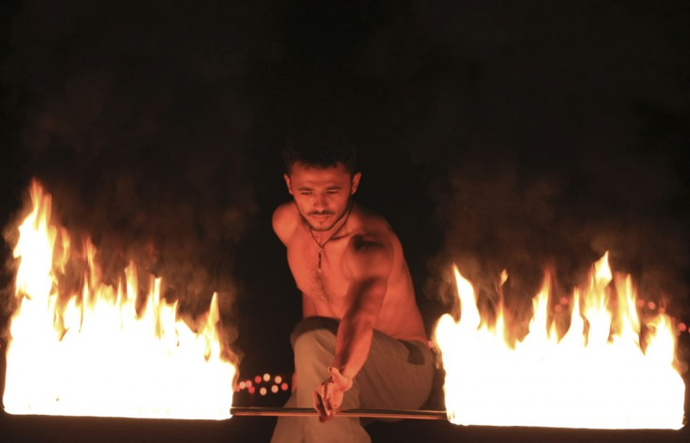 Hassan El Far, 27, performs his fire show at the Badium Sinai Arabic concert in the Red Sea resort of Sharm el-Sheikh, south of Cairo, Egypt, July 12, 2012. (Amr Abdallah Dalsh/Reuters)