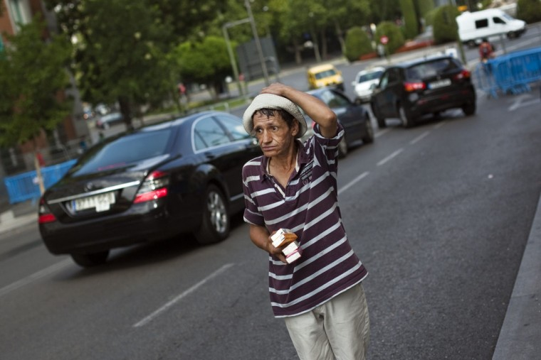 "Luis Gomez Rodriguez, 55, reacts as he tries to sell tissues to drivers at a street corner in central Madrid. Gomez Rodriguez has been working on that very same corner for the past six years. ""On a good day I make between 15 and 20 euros"", he says. ""It used to be better in the past, but now people are hurting because of the crisis and they don't give out as much"". Spain has for the first time conceded it might need a full EU/IMF bailout worth 300 billion euros ($366 billion) if its borrowing costs remain unsustainably high, a euro zone official said. (Susana Vera/Reuters)"