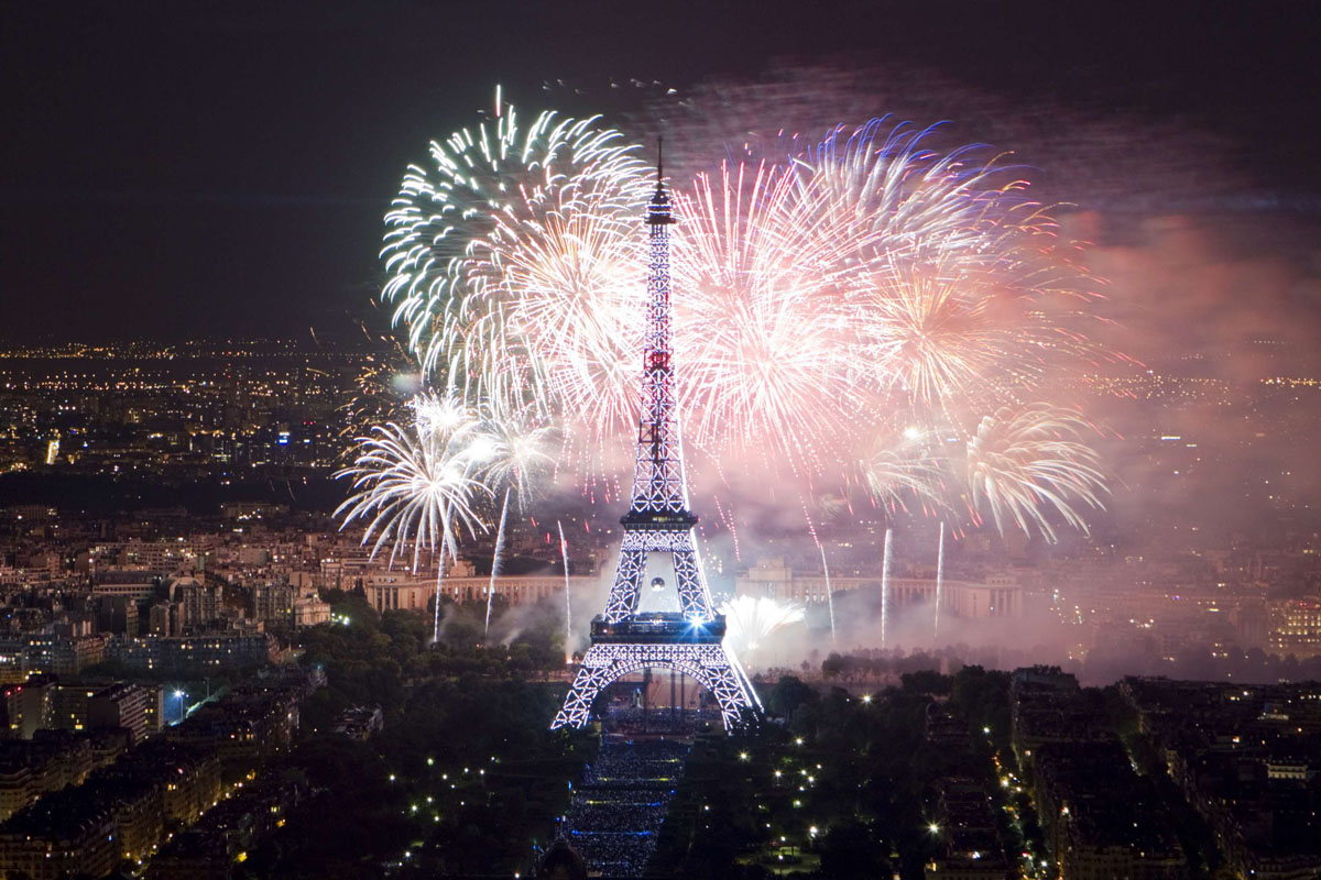 Fireworks salute Bastille Day's traditional military parade