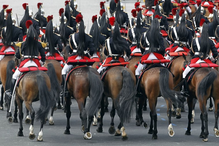 The French mounted Republican Guard take part in the traditional Bastille Day military parade in Paris July 14, 2012. (Charles Platiau/Reuters)