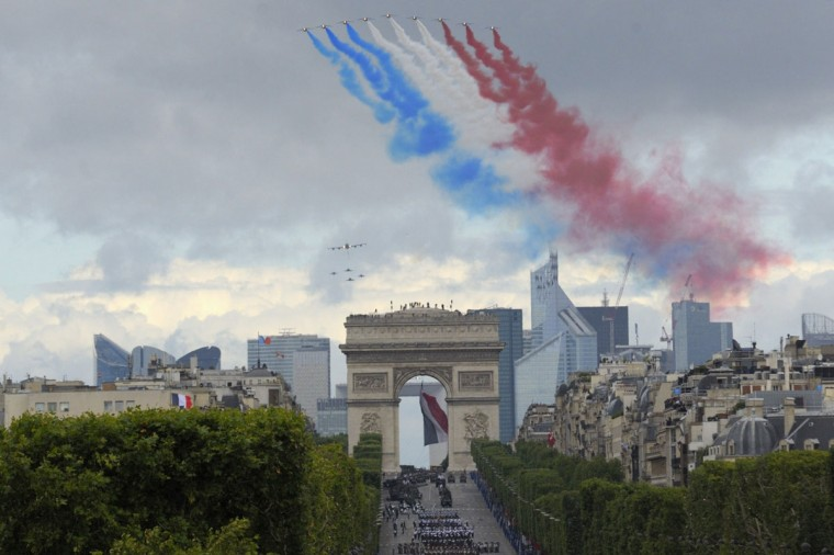 Alphajet planes from the Patrouille de France (France's Patrol) fly over the Champs Elysees during the traditional Bastille Day military parade in Paris July 14, 2012. (Philippe Wojazer/Reuters)