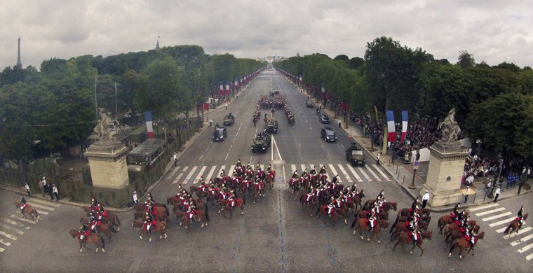 The French Republican Guard ride down the Champs Elysees during the traditional Bastille Day military parade in Paris July 14, 2012. (Philippe Wojazer/Reuters)