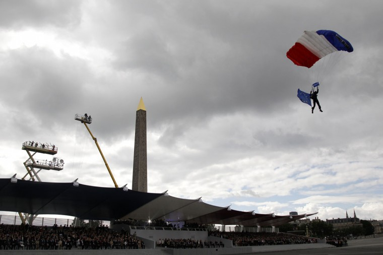 A parachutist lands in front of the reviewing stand on the Place de la Concorde during the traditional Bastille Day military parade in Paris July 14, 2012. (Benoit Tessier/Reuters)