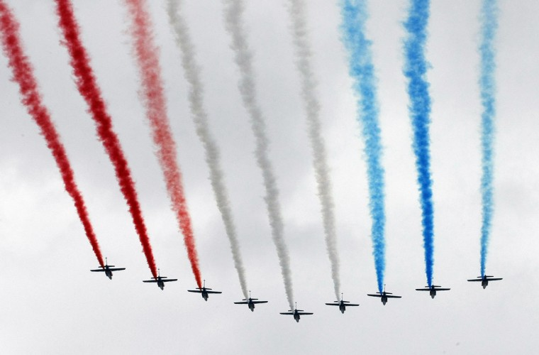 Alphajet planes from the Patrouille de France (France's Patrol) fly over the Champs Elysees as part of the traditional Bastille Day military parade in Paris July 14, 2012. (Jacques Brinon/Pool/Reuters)
