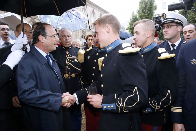 France's President Francois Hollande (L) shakes hands with a French soldier during a reception to honour the French troops at the Hotel de Brienne Defence Ministry in Paris July 13, 2012 on the eve of the traditional Bastille Day military parade. (Pierre Verdy/Pool/Reuters)