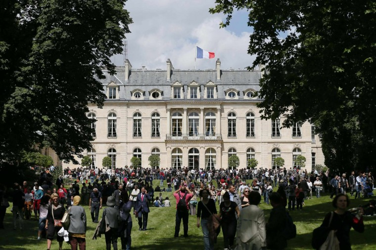 Visitors walk in the gardens of the Elysee Palace in Paris July 14, 2012. The Elysee Palace gardens are open to the public for the Bastille Day celebrations. (Kenzo Tribouillard/Pool/Reuters)