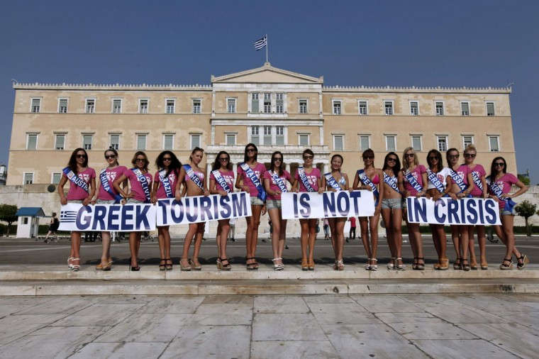 Contestants of the Miss Tourism Planet beauty contest promote their upcoming television show in front of the parliament in Athens. (Yorgos Karahalis/Reuters)