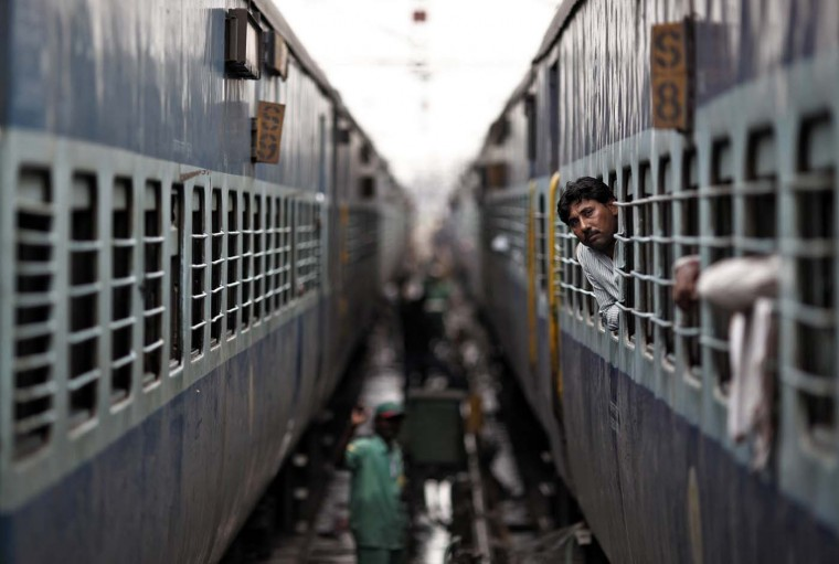 A passenger looks through the window of a train as he waits for electricity to be restored at a railway station in New Delhi July 31, 2012. Grid failure hit India for a second day on Tuesday, cutting power to hundreds of millions of people in the populous northern and eastern states including the capital Delhi and major cities such as Kolkata. (Adnan Abidi/Reuters)
