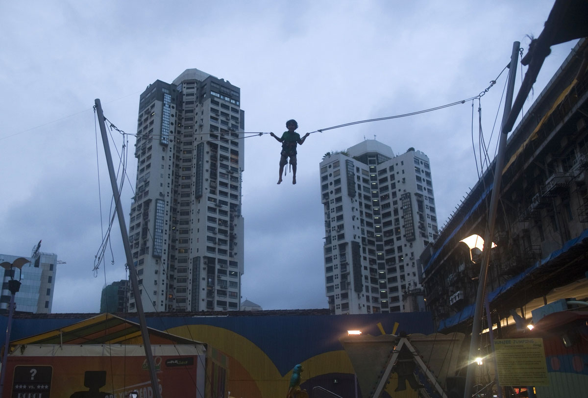 A boy plays on a giant trampoline at a mall in Mumbai. (Ahmad Masood/Reuters)