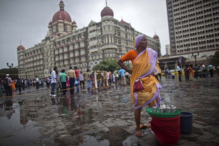 A woman sells drinking water near the Taj Mahal hotel in Mumbai July 8, 2012. (Ahmad Masood/Reuters)
