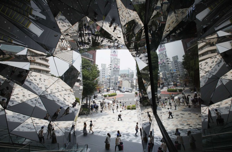 People are reflected in mirrors at an entrance of a shopping complex in Tokyo. Japan's core consumer prices fell 0.2 percent in June from a year earlier, government data showed on Friday, in a sign the country is still far from achieving the central bank's target of 1 percent inflation. (Yuriko Nakao/Reuters)