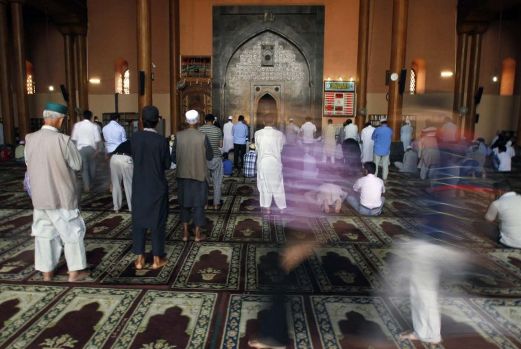 Devotees pray inside Kashmir's more than 600-year-old Jamia Masjid during the holy month of Ramadan in Srinagar July 25, 2012. (Fayaz Kabli/Reuters)