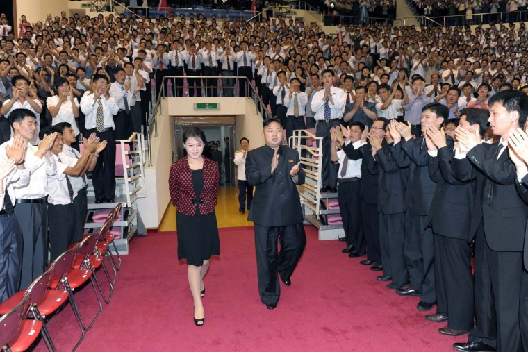 """North Korean leader Kim Jong-Un and his wife Ri Sol-Ju arrive at an auditorium to enjoy a performance given by the Moranbong Band to celebrate the 59th anniversary of """"the victory"""" of 1950-53 Korean War in Pyongyang in this picture (KCNA/Reuters)"""
