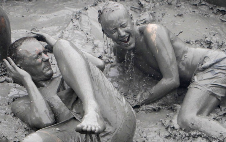 Tourists play in mud during the opening day of the Boryeong Mud Festival at Daecheon beach in Boryeong, about 190 km (118 miles) southwest of Seoul, July 14, 2012. (Lee Jae-Won/Reuters)