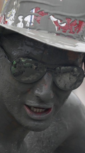 A tourist reacts as he plays in mud during the opening day of the Boryeong Mud Festival at Daecheon beach in Boryeong, about 190 km (118 miles) southwest of Seoul, July 14, 2012. (Lee Jae-Won/Reuters)