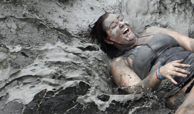 A tourist plays with mud during the opening day of the Boryeong Mud Festival at Daecheon beach in Boryeong, about 190 km (118 miles) southwest of Seoul, July 14, 2012. (Lee Jae-Won/Reuters)