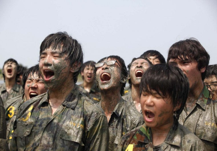 Students cheer at a summer military camp in Ansan, south of Seoul July 20, 2012. Over one thousand students and civilians will attend boot camp training courses from July till August at the Blue Dragon Camp run by retired marines. (Lee Jae-Won/Reuters)