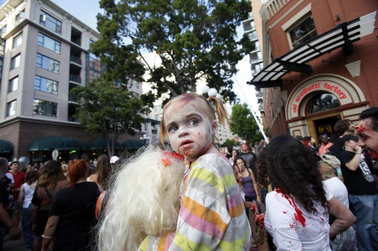 A young girl dressed up as a zombie takes part in a zombie walk in the Gaslamp Quarter during the Comic Con International convention in San Diego, California July 13, 2012. (Mario Anzuoni/Reuters)