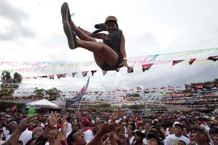 Supporters of Nicaragua's President Daniel Ortega throw a woman in the air during celebrations for the 33rd anniversary of the 'Repliegue' (Withdrawal) in Managua July 7, 2012. (Oswaldo Rivas/Reuters)