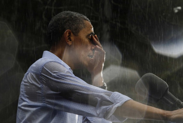 U.S. President Barack Obama wipes water off his face during a rain shower at a campaign rally in Glen Allen, Virginia. Obama traveled to Virginia on Saturday for campaign events. Rain drops on the lens created the highlights in the image. (Jason Reed/Reuters)
