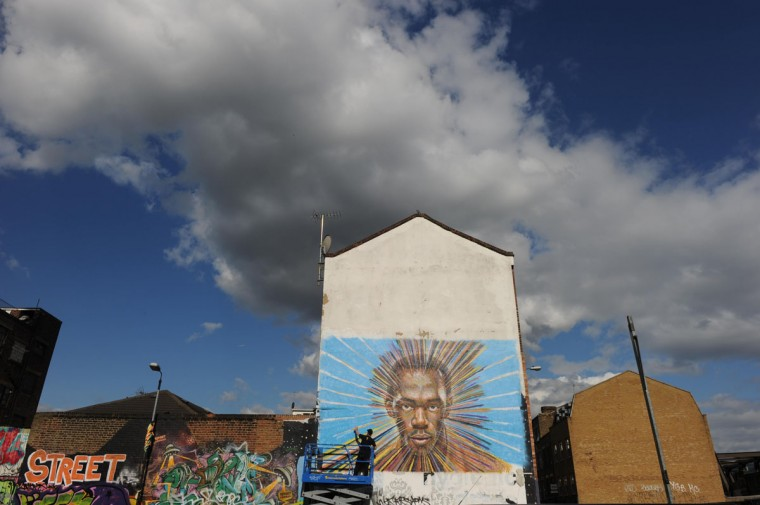 Street artist James Cochran, also known as Jimmy C, works on his spray painted picture of Jamaican sprinter Usain Bolt in Sclater street car park in east London. Cochran said this was done as an homage to the London 2012 Olympic Games, which begin July 27. (Paul Hackett/Reuters)