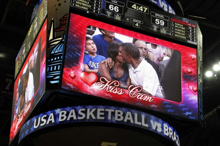 "U.S. President Barack Obama and first lady Michelle Obama are shown kissing on the ""Kiss Cam"" screen during a timeout in the Olympic basketball exhibition game between the U.S. and Brazil national men's teams in Washington. (Jonathan Ernst/Reuters photo)"