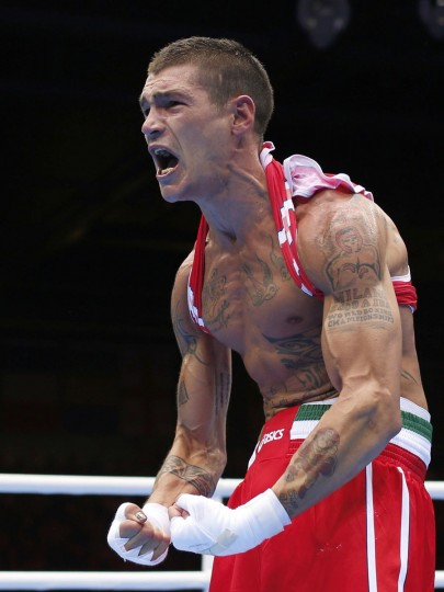 Italy's Domenico Valentino celebrates after defeating Britain's Josh Taylor in their Men's Light (60kg) Round of 16 boxing match during the London 2012 Olympic Games August 2, 2012. (Murad Sezer/Reuters)