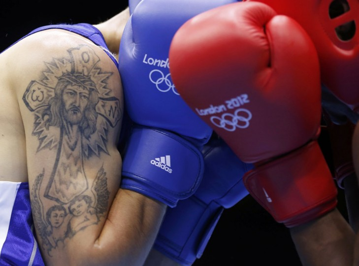Moldova's Vasilii Belous (L) sports a tattoo as he fights against Tanzania's Selemani Kidunda during the men's welter (69kg) Round of 32 boxing match at ExCeL venue during the London 2012 Olympic Games July 29, 2012. (Murad Sezer/Reuters)