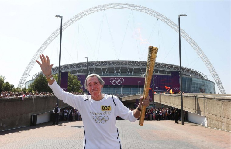 LONDON, UNITED KINGDOM - JULY 25: British soccer player Gordon Banks, who was goalkeeper for England in the 1966 World Cup, runs with the London 2012 Olympic torch outside Wembley Stadium in northwest London July 25, 2012. (Suzanne Plunkett/Reuters)