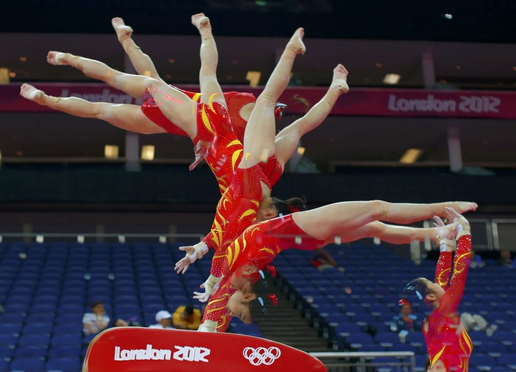 Huang Qiushuang of China attends a gymnastics training session at the North Greenwich Arena before the start of the London 2012 Olympic Games July 26, 2012. This picture was taken using multiple exposures. (Brian Snyder/Reuters)