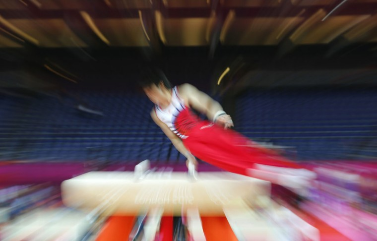 Kohei Uchimura of Japan practices on the pommel horse during a training session at the O2 Arena before the start of the London 2012 Olympic Games in London July 25, 2012. (Mike Blake/Reuters)