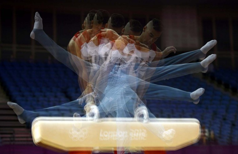Louis Smith of Britain practices on the pommel horse during a training session at the O2 Arena before the start of the London 2012 Olympic Games in London July 25, 2012. This photo was taken using multiple exposures. (Dylan Martinez/Reuters)
