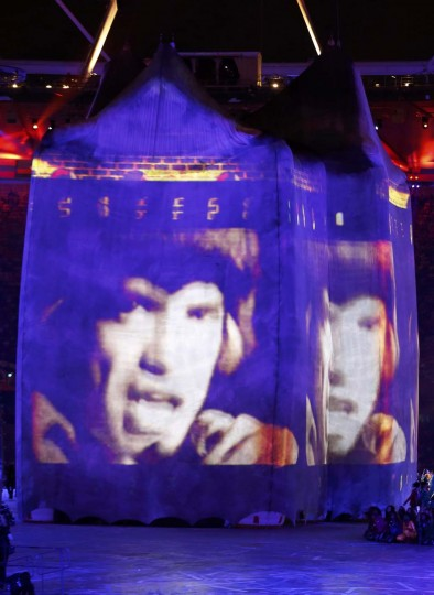 Images of British musician Mick Jagger are projected onto a structure during the opening ceremony of the London 2012 Olympic Games at the Olympic Stadium July 27, 2012. (Mike Blake/Reuters)