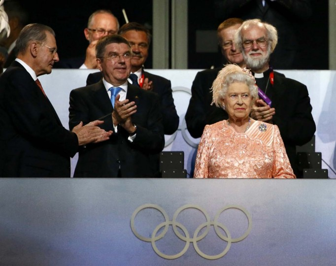 Britain's Queen Elizabeth attends the opening ceremony of the London 2012 Olympic Games with International Olympics Committee President Jacques Rogge (L), German Olympic Sports Confederation (Deutscher Olympischer Sportbund, DOSB) President Thomas Bach (2nd L) and Archbishop of Canterbury Rowan Williams (back R) at the Olympic Stadium July 27, 2012. (Kai Pfaffenbach/Reuters)