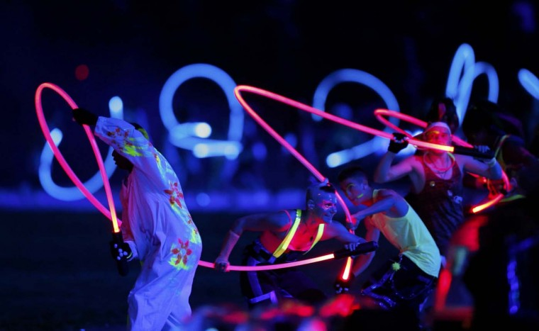 Performers take part in the opening ceremony of the London 2012 Olympic Games at the Olympic Stadium July 27, 2012. (Mike Sega/Reuters)
