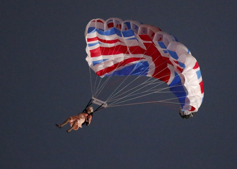 A performer playing the role of Britain's Queen Elizabeth parachutes from a helicopter during the opening ceremony of the London 2012 Olympic Games at the Olympic Stadium July 27, 2012. (Fabrizio Bensch/Reuters)