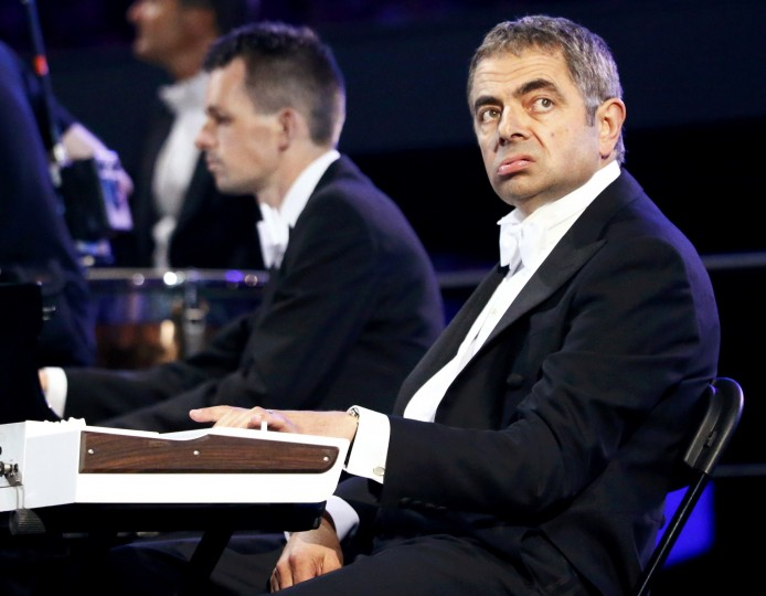 Actor Rowan Atkinson, known for his role as Mr Bean, performs during the opening ceremony of the London 2012 Olympic Games at the Olympic Stadium July 27, 2012 .(Kai Pfaffenbach/Reuters)